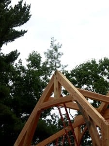 Placing of pine bough on timber frame