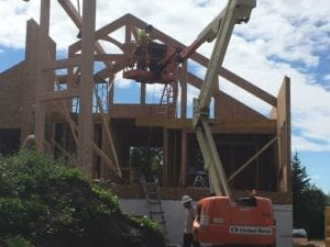 raising timber frame of a cabin