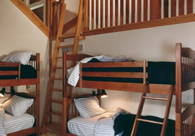 childrens bunk room bedroom with timber frame
