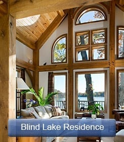 Timber frame great room looking at lake