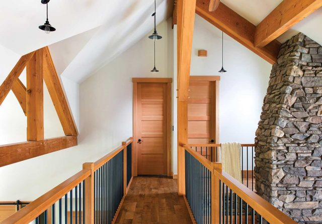 catwalk on second floor of canadian timber frame home