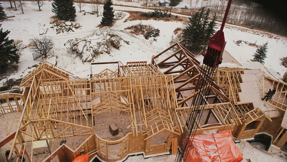 timber frame home under construction in alberta
