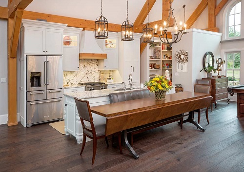 heirloom custom table in kitchen timber frame home